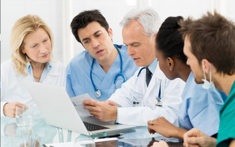 Health Professions Education Online Graduate Certificate Image of Doctors, Nurses, and Staff Learning Together