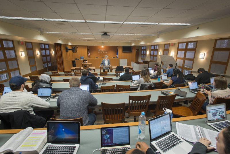 School Law Online Graduate Certificate Image of Professor Teaching Graduate Students in a Classroom