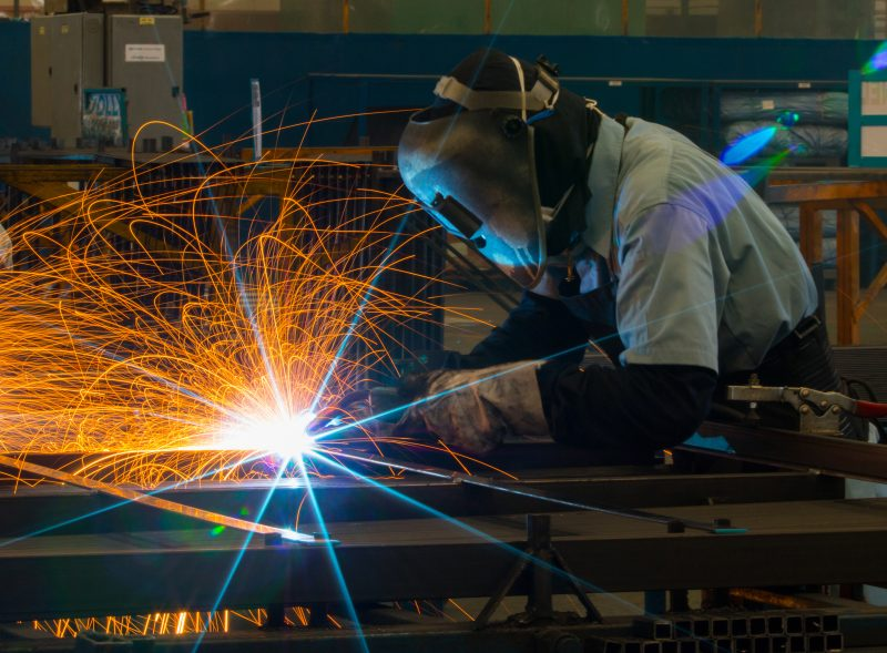 Occupational Safety and Health Online Graduate Certificate Image of Welder in Helmet Working