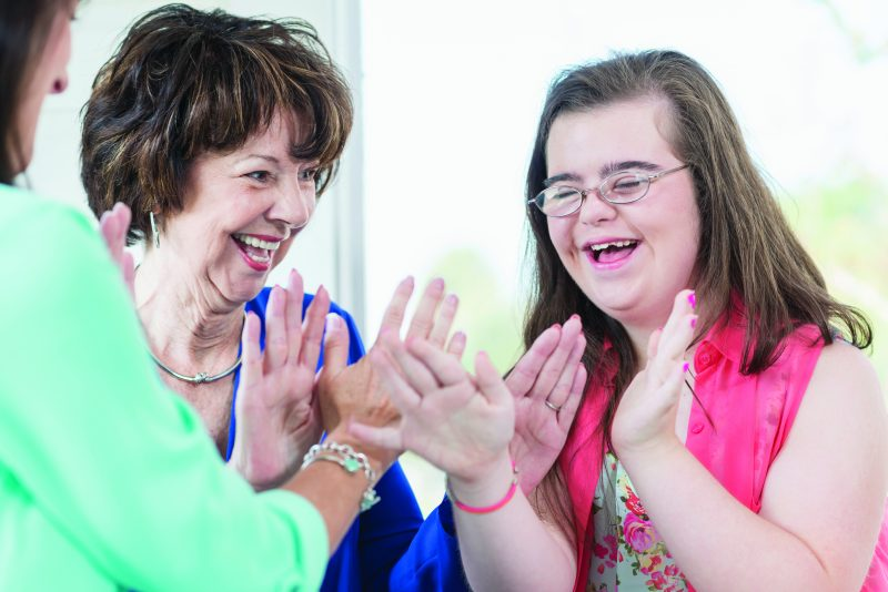 Special Education Transition to Adulthood Online Graduate Certificate Disability Instructor and Parent Working with Teenager with Down Syndrome