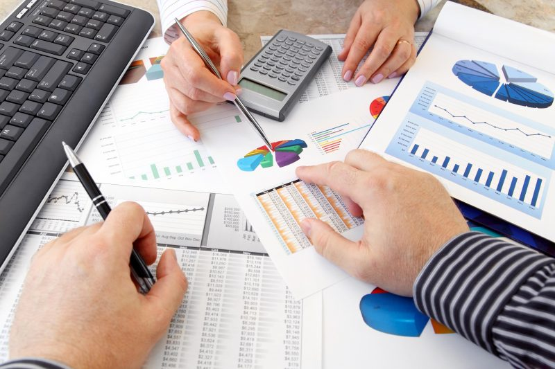 Accounting Fundamentals Online Graduate Certificate Image of Reports, Graphs, Accounting Tools and Hands